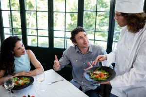 54392608 - couple complaining about the food to chef in a restaurant