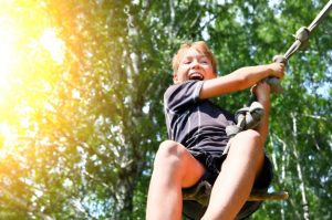 37366290 - kid bungee jumping in the summer forest