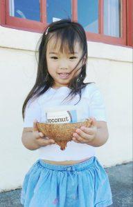 Girl holding Yoconut